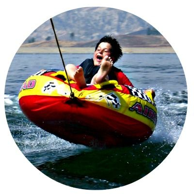 Boy tubing at Aloha Beach Camp's Castaic Lake program activity location.