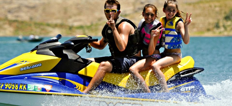 Two High Action Campers from Studio City jet skiing with their camp counselor at Aloha Beach Camp