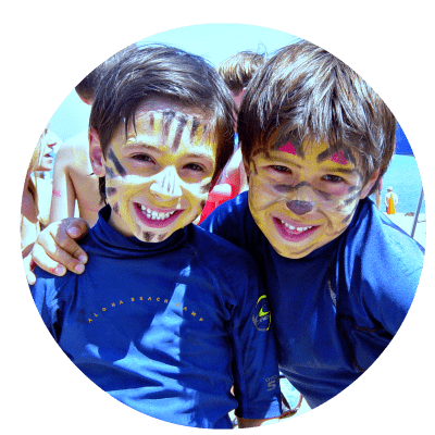 Two boys from Studio City with their faces painted like tigers enjoying a day at Aloha Beach Camp together.