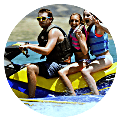 Two girls and their camp counselor jet skiing at Aloha Beach Camp.