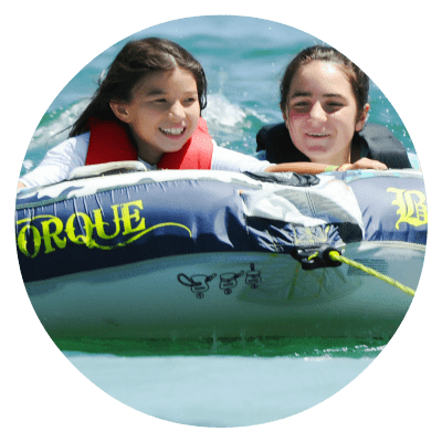 Two girls from Studio City enjoying a tubing activity Aloha Beach Camp.